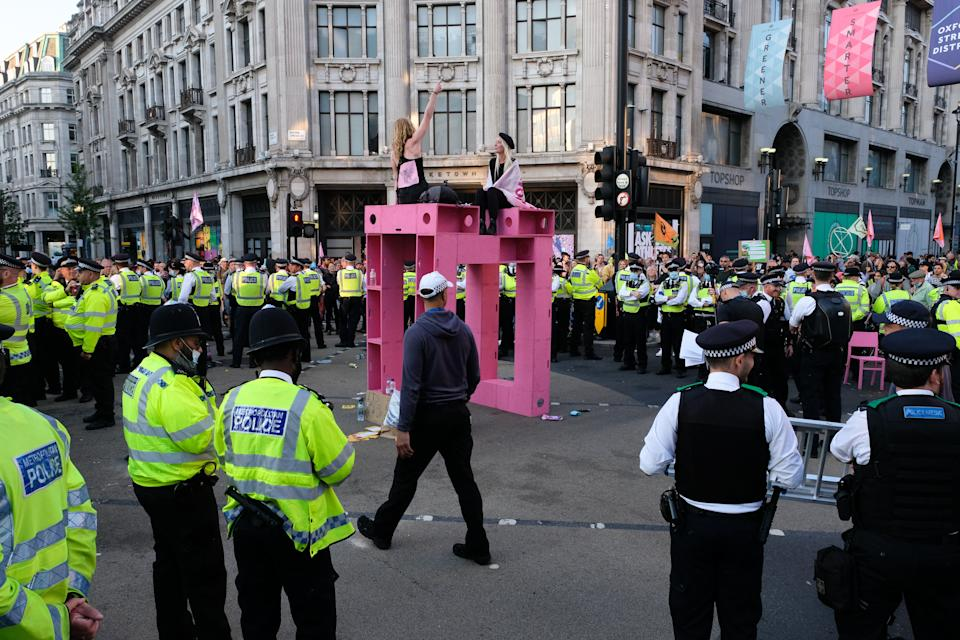 LONDON, UNITED KINGDOM - AUGUST 25, 2021 - Climate change protesters from Extinction Rebellion in Oxford Circus at the Impossible Rebellion. Protesters are arrested and carried away. (Photo credit should read Matthew Chattle/Barcroft Media via Getty Images)