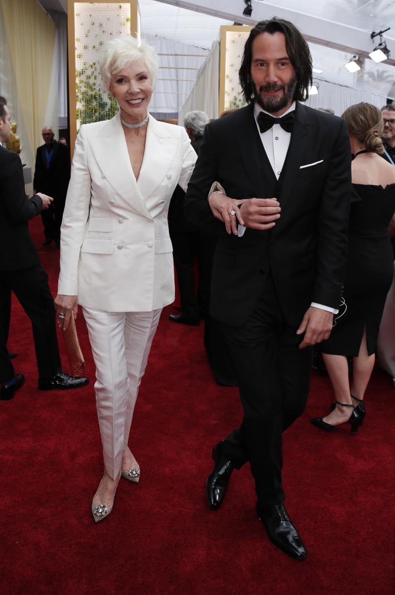 Keanu Reeves and his mother Patricia Taylor pose on the red carpet during the Oscars arrivals at the 92nd Academy Awards in Hollywood, Los Angeles, California, U.S., February 9, 2020. REUTERS/Mike Blake