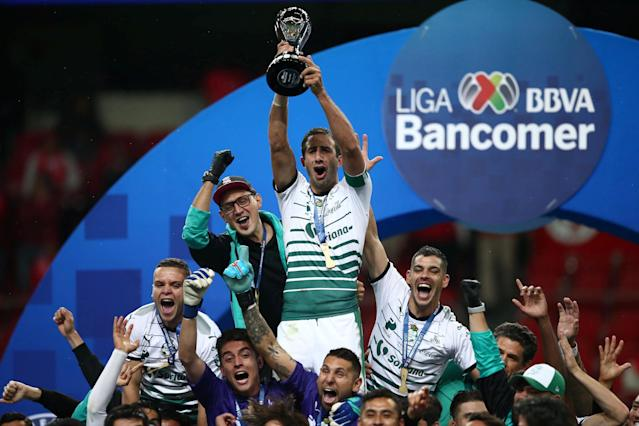 Football Soccer - Mexican First Division Final Second Leg - Toluca v Santos Laguna - Nemesio Diez stadium, Toluca, Mexico May 20, 2018. Carlos Izquierdoz of Santos Laguna holds up the trophy after winning the Mexican First Division Final. REUTERS/Edgard Garrido
