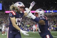 New England Patriots defensive end Chase Winovich, left, celebrates his touchdown with Deatrich Wise after a running back a blocked punt by New York Giants punter Riley Dixon in the first half of an NFL football game, Thursday, Oct. 10, 2019, in Foxborough, Mass. (AP Photo/Elise Amendola)