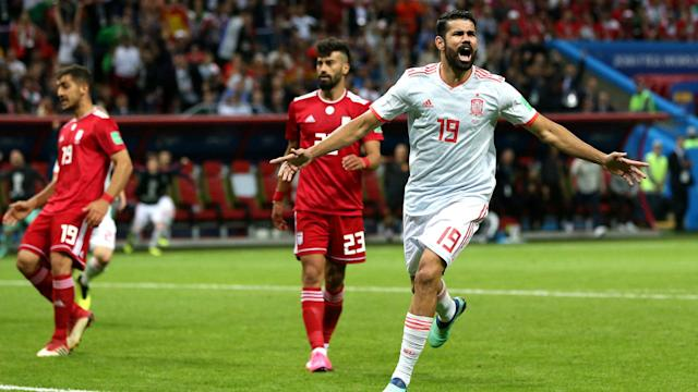 Spain have moved level on points with Portugal at the summit of Group B after edging past a spirited Iran side at the Kazan Arena.