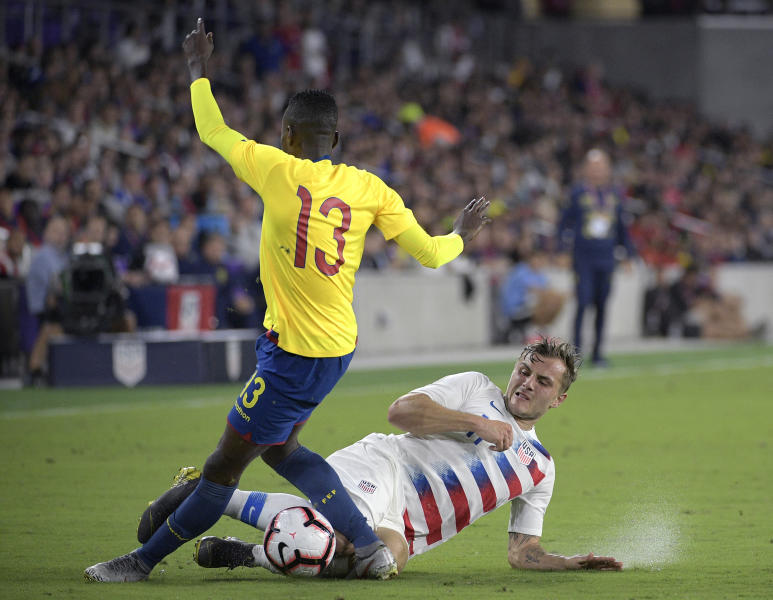 United States forward Jordan Morris, bottom, battles Ecuador defender Beder Caicedo (13) for the ball during the first half of an international friendly soccer match Thursday, March 21, 2019, in Orlando, Fla. (AP Photo/Phelan M. Ebenhack)