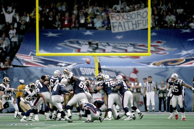 Adam Vinatieri's 48-yard field goal as time expired in Super Bowl XXXVI propelled the Patriots to a 20-17 upset victory over the St. Louis Rams. (Getty)