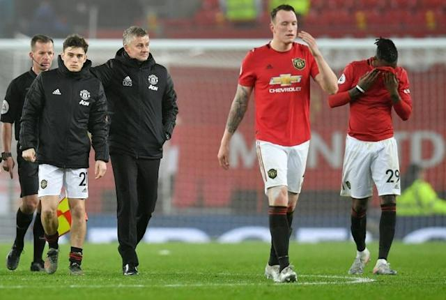 Manchester United manager Ole Gunnar Solskjaer and his players were booed off against Burnley (AFP Photo/Paul ELLIS)