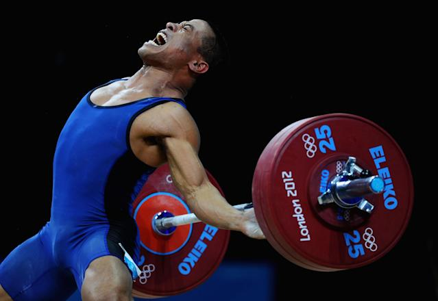LONDON, ENGLAND - JULY 30: Manuel Minginfel of Federated States of Micronesia competes in the Men's 62kg Weightlifting on Day 3 of the London 2012 Olympic Games at ExCeL on July 30, 2012 in London, England. (Photo by Laurence Griffiths/Getty Images)