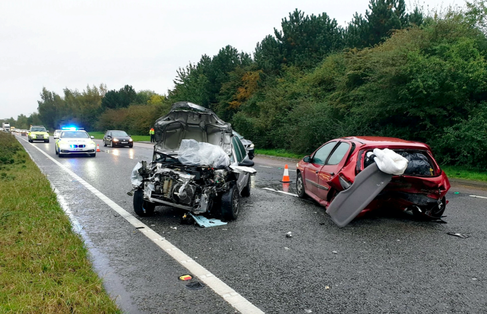 The driver of a silver Citroen Saxo ploughed into a red car which was parked in a layby after being distracted by a spider (SWNS)
