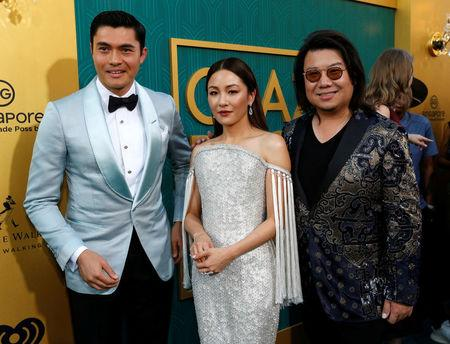 "Author Kevin Kwan (R) and cast members Henry Golding and Constance Wu pose at the premiere for ""Crazy Rich Asians"" in Los Angeles, California, U.S., August 7, 2018. REUTERS/Mario Anzuoni"