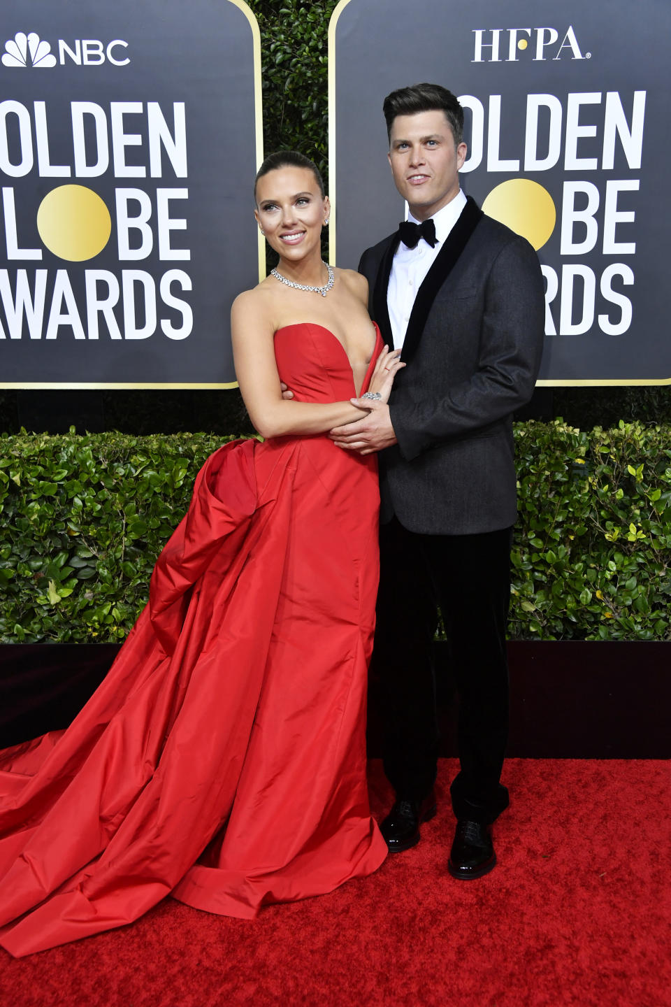 """The """"Marriage Story"""" actress and Golden Globe nominee set the red carpet on fire in a red gown by Vera Wang with fiancé Colin Jost. (Photo by Frazer Harrison/Getty Images)"""