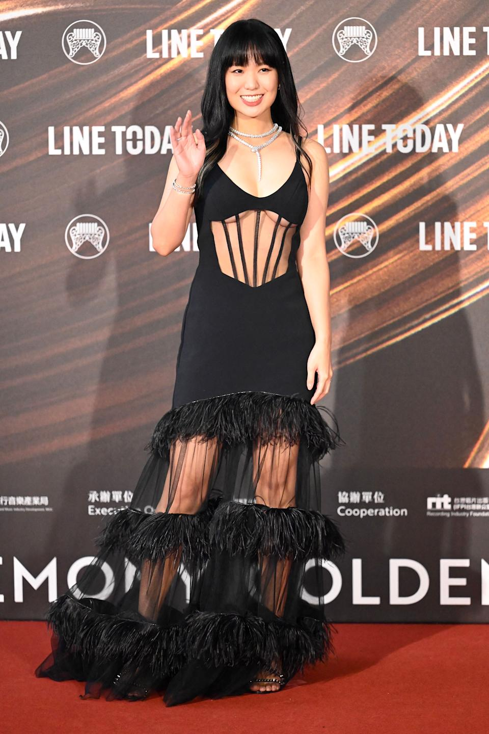 Taiwanese singer Shi Shi poses for photographs upon her arrival for the 32nd Golden Melody Awards in Taipei on August 21, 2021. (Photo by Sam Yeh / AFP) (Photo by SAM YEH/AFP via Getty Images)