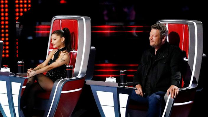 """Ariana Grande and Blake Shelton appear as coaches on 'The Voice.' Grande replaced Nick Jonas as a judge for season 21. <span class=""""copyright"""">Photo by: Trae Patton/NBC/NBCU Photo Bank via Getty Images</span>"""