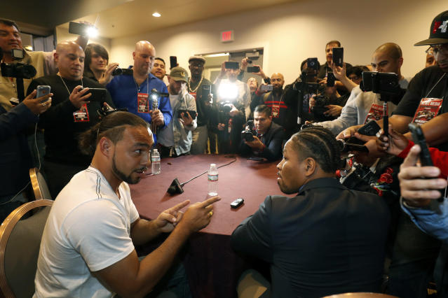WBA-WBC champion Keith Thurman (L) makes a point to former IBF champion Shawn Porter. (Getty Images)