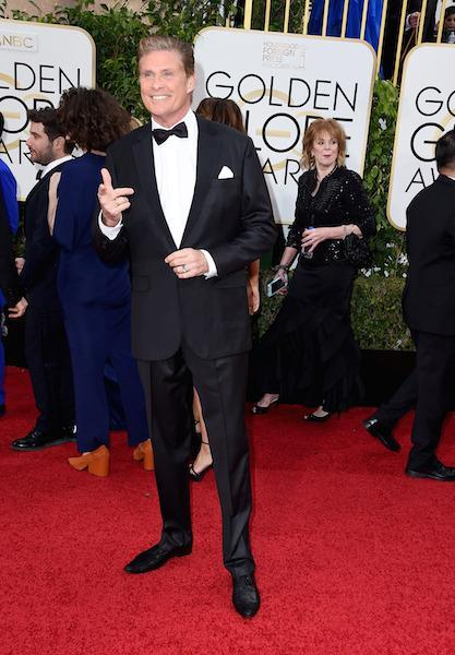 David Hasselhoff pointing, smiling, and posing on the red carpet at the 73rd Golden Globe Awards.