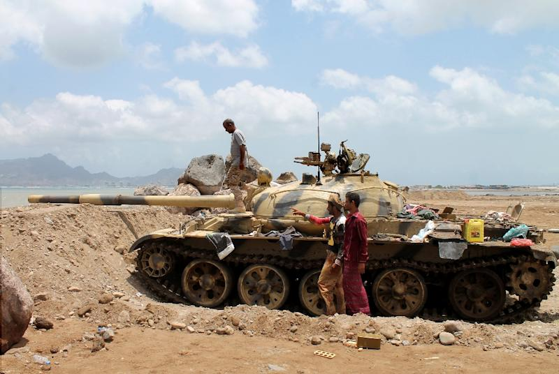 Shiite Huthi rebels man a tank near the airport in the southern Yemeni city of Aden on April 15, 2015 as Saudi-led coalition air strikes continue to strike rebel targets in the conflict ridden city (AFP Photo/Saleh Al-Obeidi)