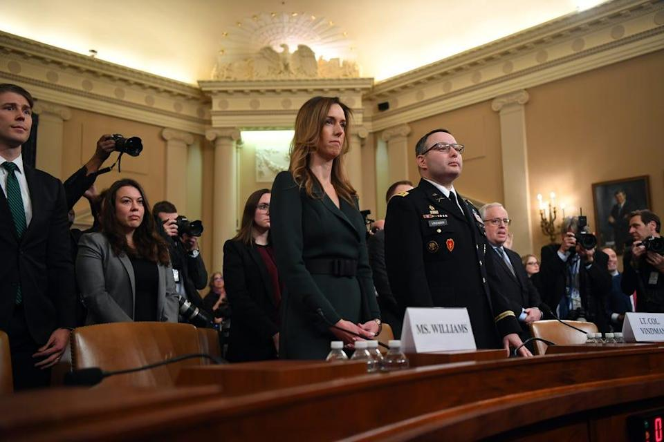 Nov 19, 2019;  Washington, DC, USA; Jennifer Williams, a foreign policy aide to Vice President Mike Pence, 2nd from left, and Lieutenant Colonel Alexander Vindman, a Ukraine expert for the National Security Council, arrive to testify on Nov. 19, 2019 before the Permanent Select Committee on Intelligence.