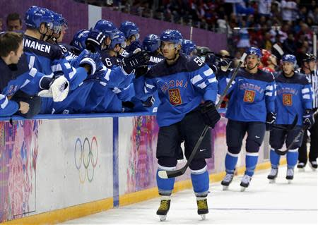Finland's Juhamatti Aaltonen (50) celebrates his goal against Russia with teammates during the first period of their men's quarter-finals ice hockey game at the Sochi 2014 Winter Olympic Games February 19, 2014. REUTERS/Mark Blinch