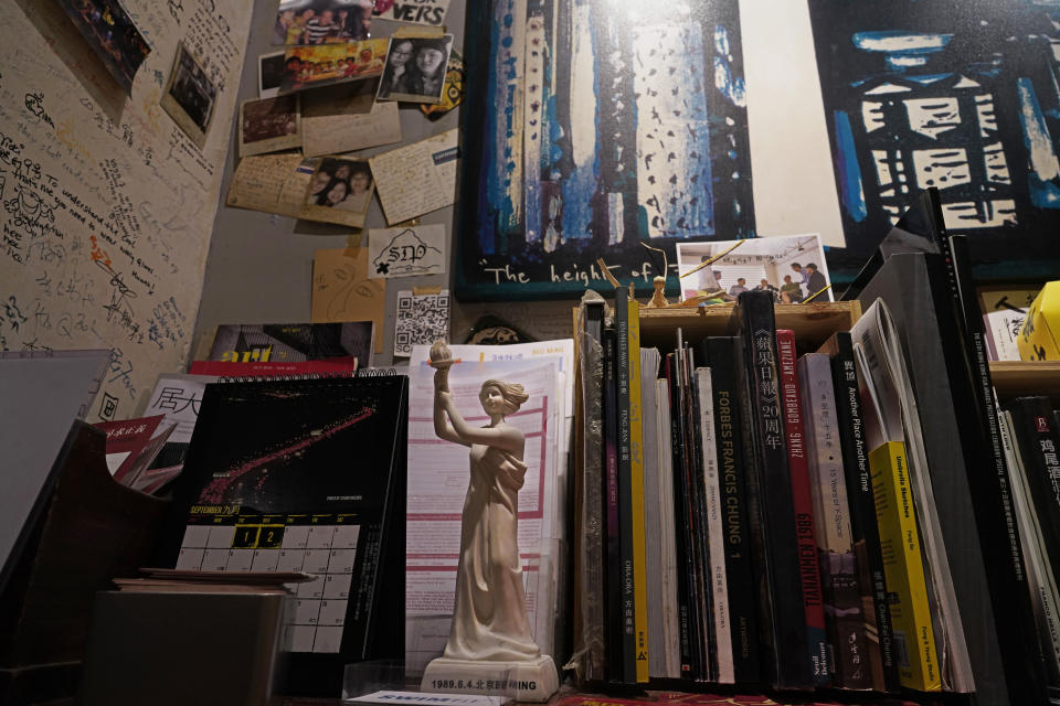 In this Oct. 7, 2020 photo, the statue of the Goddess of Democracy is displayed at Club 71 in Hong Kong. The bar known as a gathering place for pro-democracy activists and intellectuals is closing. (AP Photo/Vincent Yu)