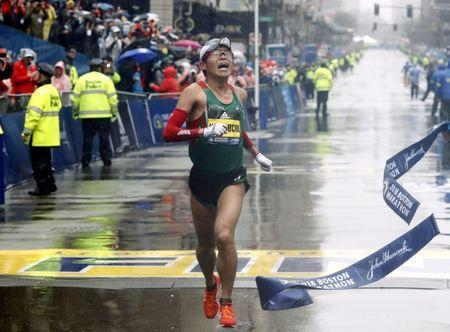 Apr 16, 2018; Boston, MA, USA; Yuki Kawauchi of Japan hits the tape to win the Men's Division of the 2018 Boston Marathon. Mandatory Credit: Winslow Townson-USA TODAY Sports