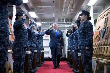 U.S. Vice President Mike Pence, salutes as he boards the USS Ronald Reagan aircraft carrier in Yokosuka, Kanagawa, Japan, on Wednesday, April 19, 2017. REUTERS/Tomohiro Ohsumi/Pool