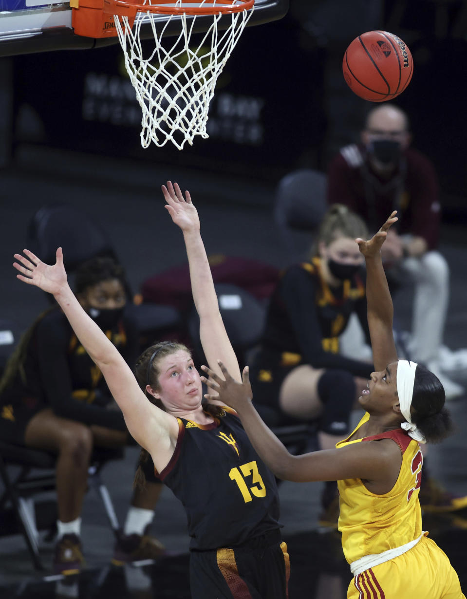Southern California forward Jordyn Jenkins (32) shoots as Arizona State guard Maggie Besselink (13) defends during an NCAA college basketball game in the first round of the Pac-12 women's tournament Wednesday, March 3, 2021, in Las Vegas. (AP Photo/Isaac Brekken)