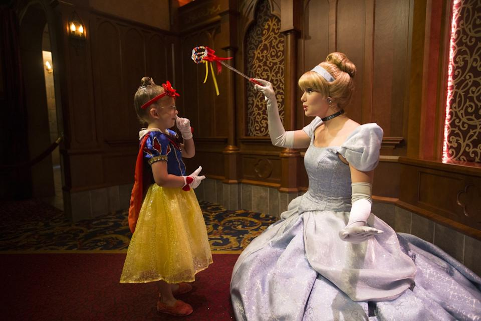 Cloie Lowry, 4, of Rock Springs, Wyo., meets Cinderella in Fantasy Faire Royal Hall, where kids meet Disney princesses.