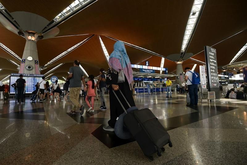 Travellers have been advised to be at their respective terminals at least four hours ahead of departure to avoid missing their flights. — Picture by Miera Zulyana