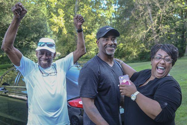 PHOTO: Chester Hollman III celebrates with his father Chester Hollman, Jr., left and his sister Deanna as he takes his first steps of freedom from the State Correctional Institution at Retreat in Hunlock Creek, Pennsylvania on Monday, July 15, 2019. (Steven M. Falk/The Philadelphia Inquirer/TNS/Newscom)