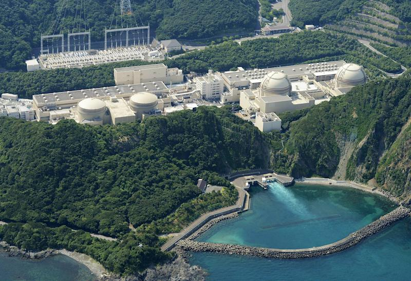 This aerial photo shows Kansai Electric Power Co.'s unit buildings, from left, No. 1, No. 2, No. 3, and No. 4 of the Ohi nuclear power plant in Ohi, Fukui prefecture, western Japan, Friday, Nov. 2, 2012. Japanese nuclear regulators inspected ground structures Friday at the country's only operating nuclear plant to examine if an existing fault line is active. The inspection determines whether the Ohi plant should close. Its No. 3 and No. 4 reactors went back online in July, becoming Japan's only operating reactors after all 50 Japanese reactors went offline for inspection following the March 11, 2011, crisis at Fukushima Dai-ichi. (AP Photo/Kyodo News) JAPAN OUT, MANDATORY CREDIT, NO LICENSING IN CHINA, FRANCE, HONG KONG, JAPAN AND SOUTH KOREA