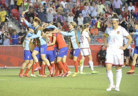 Jun 17, 2015; Ottawa, Ontario, CAN; Korea celebrates after defeating Spain 2-1 in a Group E soccer match in the 2015 FIFA women's World Cup at Lansdowne Stadium. Mandatory Credit: Eric Bolte-USA TODAY Sports