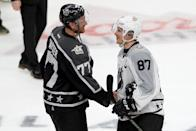 Jeff Carter (L) of the Los Angeles Kings greets Sidney Crosby of the Pittsburgh Penguins after the Metropolitan Division All-Stars defeated the Pacific Division All-Stars, in the 2017 Honda NHL All-Star Tournament Final, on January 29 (AFP Photo/Sean M. Haffey)