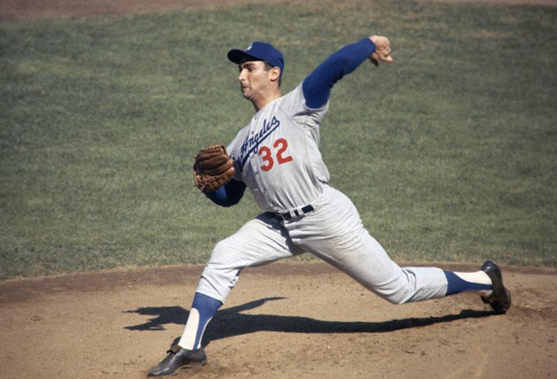 UNDATED: Pitcher Sandy Koufax #32 of the Los Angeles Dodgers uncorks a pitch during the 1960s. (Photo by Focus On Sport/Getty Images)