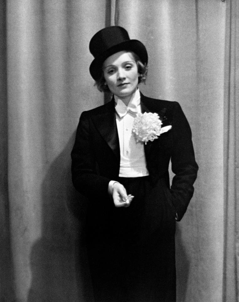 "<p>The German actress had gotten quite comfortable in a tux at this point, having already performed ""Give Me the Man,"" her first Hollywood film, costarring Gary Cooper. </p>"