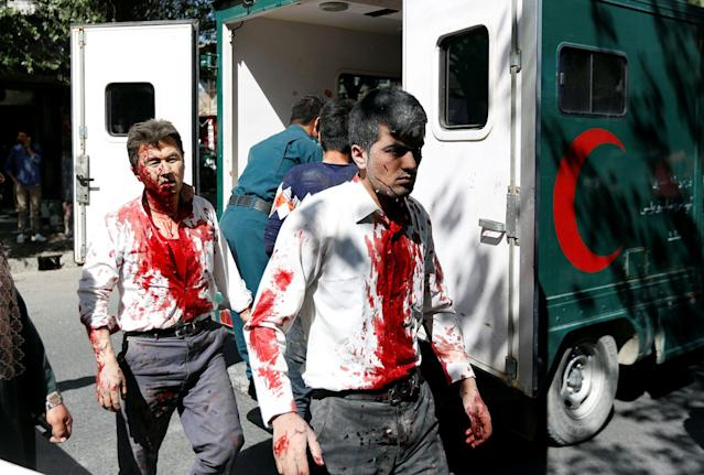 <p>Injured Afghan men arrive at a hospital after a blast in Kabul, Afghanistan May 31, 2017.(Mohammad Ismail/Reuters) </p>