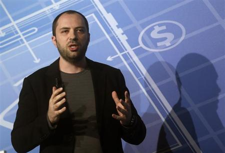 WhatsApp CEO and co-founder Jan Koum delivers a speech at the Mobile World Congress in Barcelona