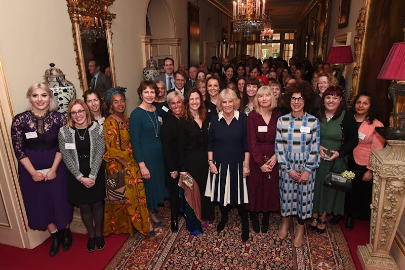 LONDON, ENGLAND - FEBRUARY 12: Camilla, Duchess of Cornwall poses with CEO of SafeLives Suzanne Jacob and guests of a reception to acknowledge the 15th anniversary of domestic abuse charity SafeLives at Clarence House on February 12, 2020 in London, England. (Photo by Eamonn M. McCormack/Getty Images)