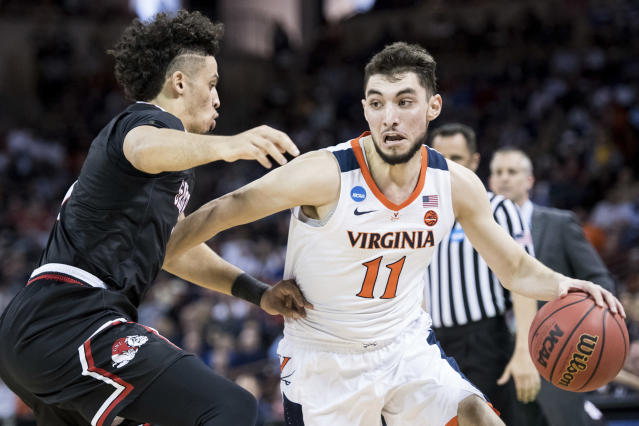 Virginia guard Ty Jerome (11) dribbles the ball against Gardner-Webb guard Jose Perez, left, during a first-round game in the NCAA mens college basketball tournament Friday, March 22, 2019, in Columbia, S.C. (AP Photo/Sean Rayford)