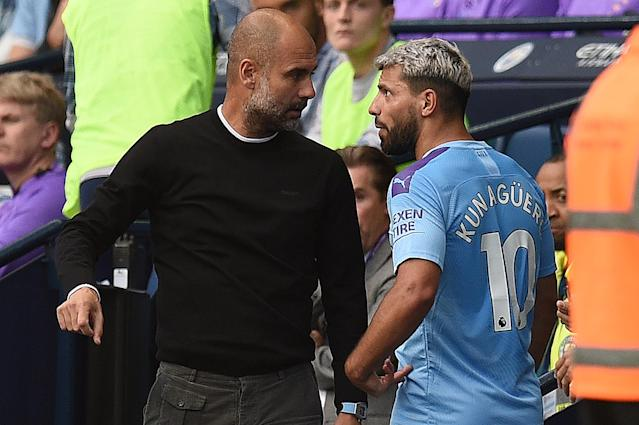 Manchester City's Argentinian striker Sergio Aguero (R) talks with manager Pep Guardiola as he is substituted off. (Photo credit should read OLI SCARFF/AFP/Getty Images)