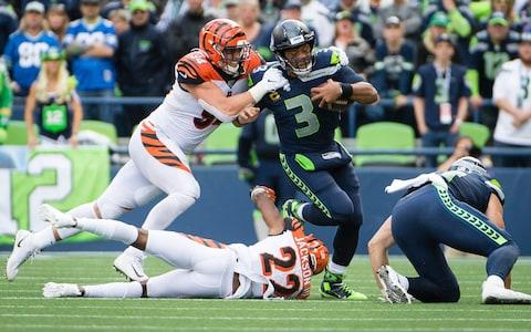 <span>Russell Wilson on the run before being tackled by Sam Hubbard</span> <span>Credit: USA Today </span>