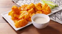 "<p>You can't have a Super Bowl without Buffalo wings—but they don't need to be chicken. Sub out the milk in this recipe for your favorite milk alternative—and use a dairy-free ranch for dipping.</p><p><strong>Get the recipe at <a href=""https://www.delish.com/cooking/recipe-ideas/recipes/a49855/cauliflower-wings-recipe/"" rel=""nofollow noopener"" target=""_blank"" data-ylk=""slk:Delish"" class=""link rapid-noclick-resp"">Delish</a>.</strong></p><p><a class=""link rapid-noclick-resp"" href=""https://www.amazon.com/Nordic-Ware-Natural-Aluminum-Commercial/dp/B0049C2S32/?tag=syn-yahoo-20&ascsubtag=%5Bartid%7C10050.g.35120802%5Bsrc%7Cyahoo-us"" rel=""nofollow noopener"" target=""_blank"" data-ylk=""slk:SHOP BAKING SHEETS"">SHOP BAKING SHEETS</a></p>"