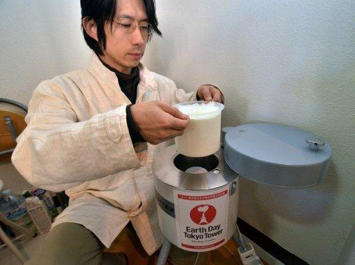 Hidetake Ishimaru, a representative of a firm which checks for radiation levels, demonstrates how to use a scintillator to measure radiation levels of a sample of milk at his shop in Tokyo. For Japanese shoppers, food safety was taken for granted until the Fukushima crisis