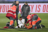 Real Madrid's Rodrygo sits on the pitch with an injury during the Spanish La Liga soccer match between Real Madrid and Granada at the Alfredo Di Stefano stadium in Madrid, Spain, Wednesday, Dec. 23, 2020. (AP Photo/Bernat Armangue)
