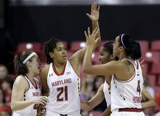 Maryland forward Tianna Hawkins (21) high-fives teammates after being fouled as she scored a basket in the first half of an NCAA college basketball game against George Mason in College Park, Md., Saturday, Dec. 8, 2012. (AP Photo/Patrick Semansky)