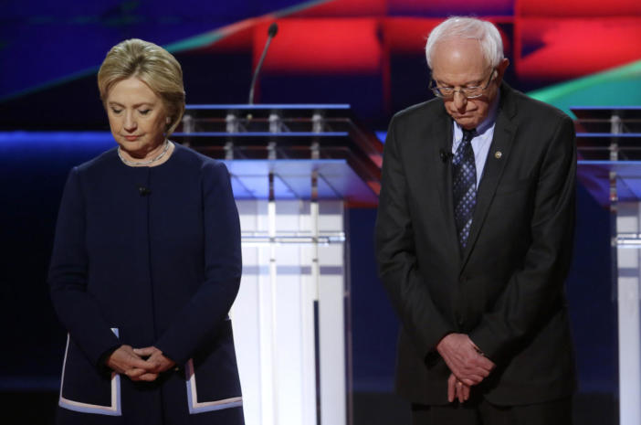 <p>Democratic presidential candidates Hillary Clinton and Bernie Sanders observe a moment of silence on Sunday for Nancy Reagan before the Democratic presidential primary debate at the University of Michigan-Flint.<i> (Photo: Carlos Osorio/AP)</i></p>