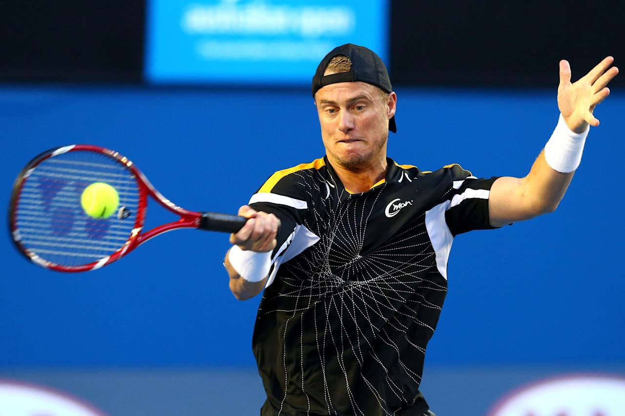 MELBOURNE, AUSTRALIA - JANUARY 14:  Lleyton Hewitt of Australia first round match against Janko Tipsarevic of Serbia during day one of the 2013 Australian Open at Melbourne Park on January 14, 2013 in Melbourne, Australia.  (Photo by Ryan Pierse/Getty Images)