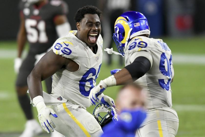 Los Angeles Rams nose tackle Sebastian Joseph-Day (69) celebrates with defensive end Aaron Donald (99) after the team defeated the Tampa Bay Buccaneers during an NFL football game Monday, Nov. 23, 2020, in Tampa, Fla. (AP Photo/Jason Behnken)