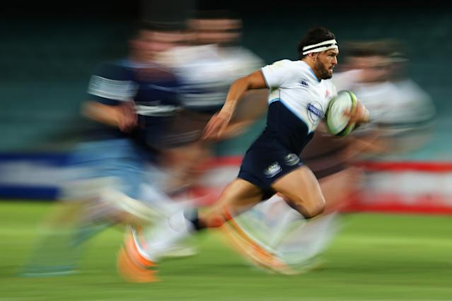 SYDNEY, AUSTRALIA - FEBRUARY 07: Adam Ashley-Cooper of the Waratahs runs the ball during the Super Rugby trial match between the Waratahs and the Blues at Allianz Stadium on February 7, 2014 in Sydney, Australia. (Photo by Mark Kolbe/Getty Images)