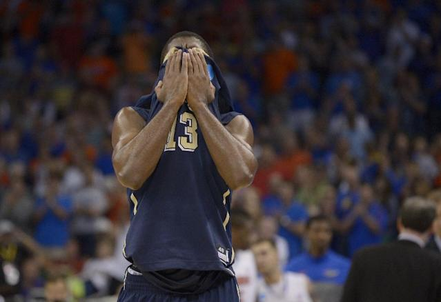 Pittsburgh guard Josh Newkirk (13) shields his face at the end of the third-round game in the NCAA college basketball tournament Saturday, March 22, 2014, in Orlando, Fla. Florida defeated Pittsburgh 61-45. (AP Photo/Phelan M. Ebenhack)