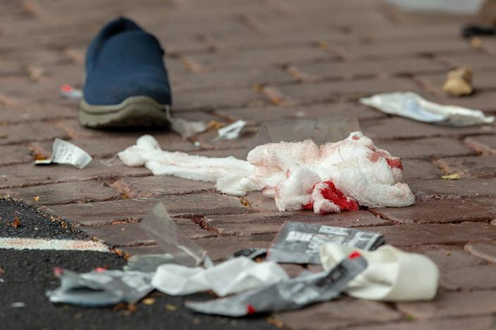 <p>Bloodied bandages on the road following a shooting resulting in multiply fatalities and injuries at the Masjid Al Noor on Deans Avenue in Christchurch, New Zealand. EPA/Martin Hunter </p>