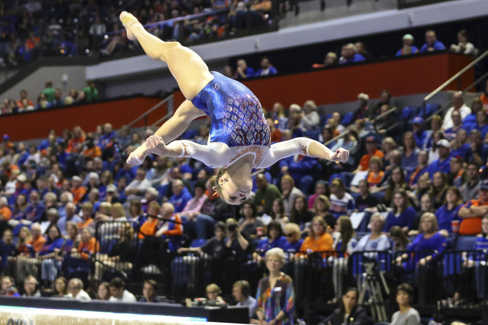 Florida's Rachel Gowey competes on the balance beam during an NCAA gymnastics match against Missouri, Friday, Jan. 11, 2019, in Gainesville, Fla. (AP Photo/Gary McCullough)