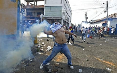 Venezuelans hold a protest in the border city of Urena - Credit: AFP