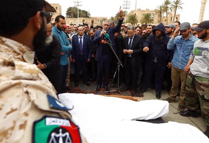 Omar al-Hassi, the head of Libya's self-declared Islamist-backed government, delivers a speech on March 22, 2015, in the capital Tripoli, during the funeral procession of Salah Al-Borke, a field commander at Fajr Libya (Libya Dawn) (AFP Photo/Mahmud Turkia)